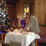 Greg Shultz lighting the candles